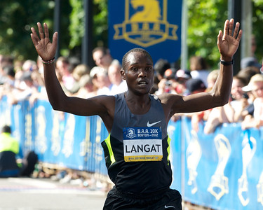 062412, Boston, MA - Runnerhilip Langat of Kenya crosses the finish line at the Second Annual Boston Athletic Assicoation 10K with a final time of 27:53 - good enough for a second place finish. Herald photo by Ryan Hutton