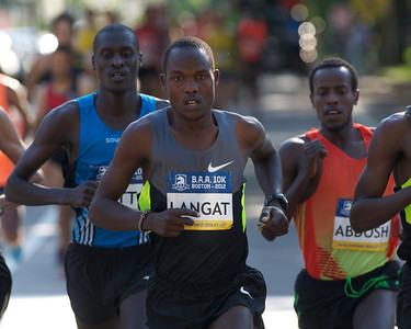 062412, Boston, MA - Runner Philip Langat of Kenya, center, leads the pack temporarily during the Second Annual Boston Athletic Assicoation 10K. Herald photo by Ryan Hutton