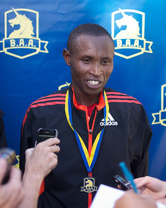 062412, Boston, MA - Runner Geoffrey Mutai of Kenya talks to the press following his first place finish in the Second Annual Boston Athletic Assicoation 10K. Herald photo by Ryan Hutton