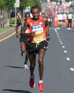 062412, Boston, MA - Runner Geoffrey Mutai of Kenya breaks away from the pack during the final few kilometers of the Second Annual Boston Athletic Assicoation 10K. Herald photo by Ryan Hutton