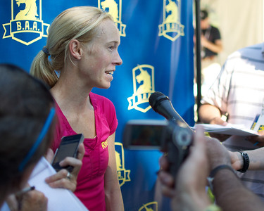 062412, Boston, MA - Runner Kim Smith of Providence talks to the press after earning a first place finish in the women's division of Second Annual Boston Athletic Assicoation 10K with a final time of 31:36. Herald photo by Ryan Hutton