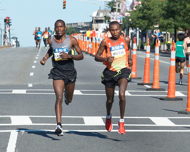 062412, Boston, MA - Runners Philip Langet and Geoffrey Mutai, both of Kenya, run neck and neck as they continue to pull away from the pack slightly more than half way through the  Second Annual Boston Athletic Assicoation 10K. Herald photo by Ryan Hutton