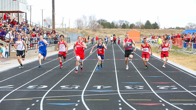 Hemingford's Brady Turek pulls ahead of Lingle's Chastin Hill in the 100 meter dash at the Bayard C-D track meet in Bayard on Saturday.
