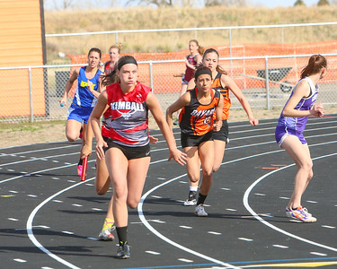Kimball's Kelly Green prepares to get the batton from teammate Brooke Hager, with Bayard's Jessi Smith getting the batton from Chellani Parriott. Smith was able to catch-up and pass Green to win the 4x100 meter relay.