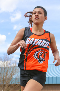 Bayard's Jessi Smith turns the corner in the girls 800 meter run. Set a new meet record. 2:23:31