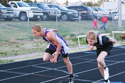 Garden County's Kane McLaughlin goes to the wire with Haxtun's Colin Munster in the boys 300 meter hurdles