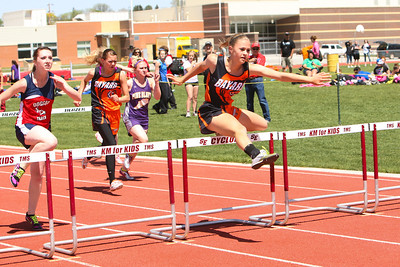 Bayard's Chellani Parriott clears a hurdle in the girls 100 meter hurdles during the Goshen County Track and field meet in Torrington on Monday.