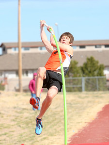 """Mitchell's Andrew Thomas competing in the boys pole vault during the Kimball invite on Saturday. Thomas would win the event with a vault of 11' 0""""."""