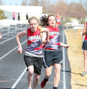 The Kimball Longhorns hosted the Kimball Invite on Saturday. Kimball's Regan Hinton (back) hands off the baton to teammate Hailee Simpson during the girls 4 x 800 relay.