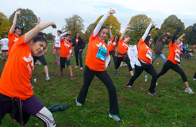 102012, Boston, MA - A group of racers starts the day with a little stretching and yoga at the Komen Massachusetts Race for the Cure at Joe Moakley Park on Saturday morning. Herald photo by Ryan Hutton