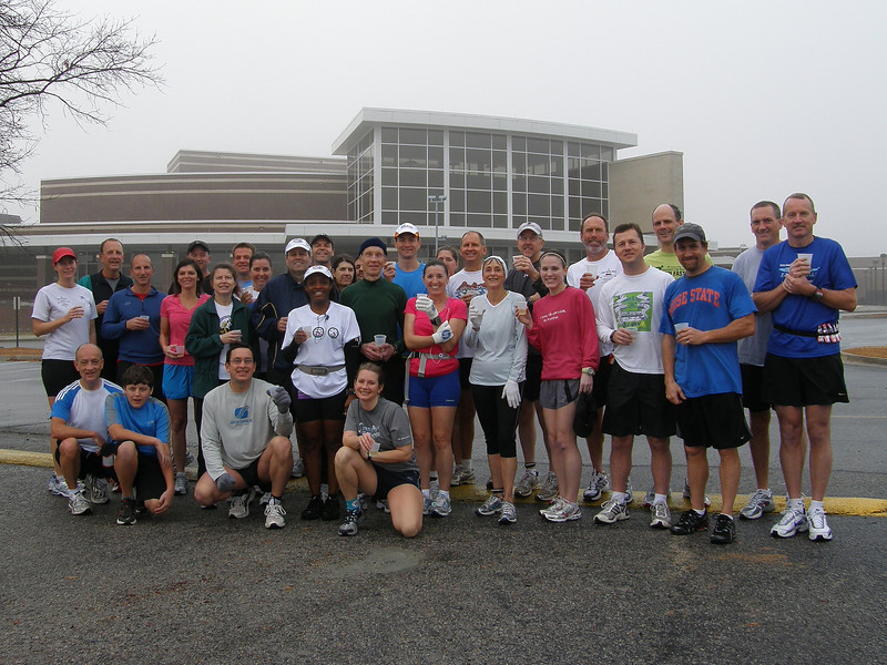 Over a decade ago, I found the joy of running, joining with some friends who run every Saturday morning.  This is our latest gathering for an annual New Year's Day run welcoming 2011 with a toast of sparkling grape juice.  Lexington High School Auditorium in the background.