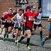 Groepje achtervolgers met o.a. Geert Verkruysse van FLAC Hoppeland - Milcobel Run 2014 - Langemark - West-Vlaanderen