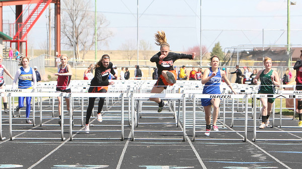 Bayard's Chellani Parriott clears the last hurdle on Thursday at the Tri-State Track Meet in Chappell. Parriott wins the event.