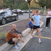 Emily looking determined and Jon looking amused before final track workout for the Baltimore Half Marathon 2010