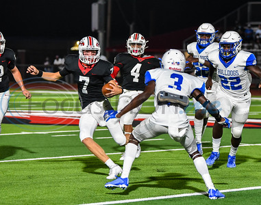 Rusk junior quarterback Owen McCown (7) scrambles away from the Crockett Bulldog defense during the first quarter of a game hosted by Rusk on Friday. McCown transferred to Rusk with his brother Aiden McCown, who is a sophomore, this year.
