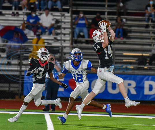 Rusk Eagles sophomore Aiden McCown (14) jumps to intercept the ball in a game against the Crockett Bulldogs on Friday.