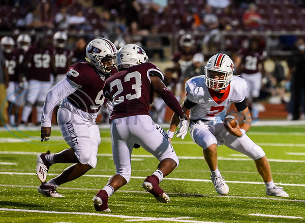 Rusk quarterback Owen McCown (7)  looks to shake off two Palestine defenders in a game hosted by Palestine on Friday. The Eagles fell to the Wildcats to in their third game of the season to go 2-1.
