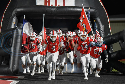 The Rusk Eagles take the field with American flags in honor of Veteran's Day for their last home game of the season. The Eagles took on the Wills Point Tigers who went on to win the game. (Jessica T. Payne/Tyler Morning Telegraph)