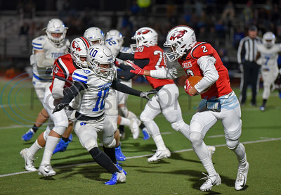 Rusk senior Brennen Lucien (2) prepares to stiff arm Angel Crew (10) of Wills Point in the final game of the regular season on Friday. Wills Point went on to win the game 46-18. (Jessica T. Payne/Tyler Morning Telegraph)