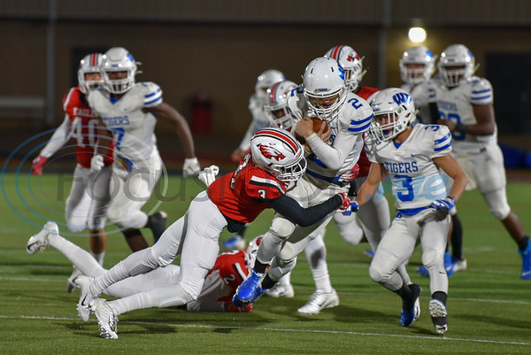Isiah Ward (3) of Rusk leaps to tackle Wills Point's Tyler Baker (2) in the final game of the regular season. The Wills Point Tigers traveled to Rusk for the game on Friday where they went on to win. (Jessica T. Payne/Tyler Morning Telegraph)
