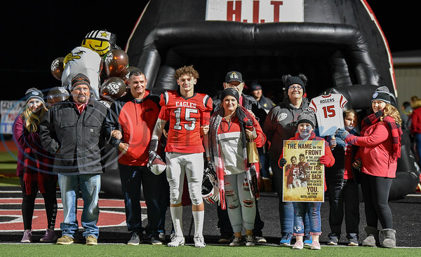 Rusk Eagles senior Sean Rogers (15) celebrates Senior Night with his family at Rusk's final home game and last game of the regular season on Friday. (Jessica T. Payne/Tyler Morning Telegraph)