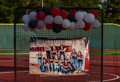 A banner featuring Rusk softball players and balloons were on display in front of home plate for a surprise Senior Softball Night on Wednesday, May 13. New Head Coach Michael Williams invited seniors and their parents to walk the field one last time to be recognized.