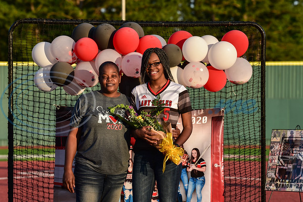 Rusk High School senior Jamyah Anderson (right) stands with her mother Pam King during a surprise Senior Softball Night on Wednesday, May 13. Seniors were recognized in front of home plate with flowers, framed jersey number and gifts.
