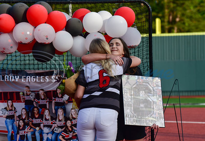Rusk senior Alanna Goldsberry hugs Assistant Softball Coach Katy Stover during a surprise Senior Softball Night party on Wednesday, May 13. The seniors took the field for the last time to be honored as their season was cut short due to the coronavirus.
