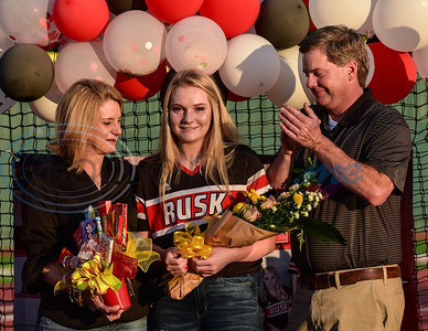 Grace Young (center) smiles through tears with parents Dana and Austin Young while being honored during a surprise Senior Softball Night event on May 13.  Only one family at a time were allowed to take the field one last time with their senior due to social restrictions due to the coronavirus.