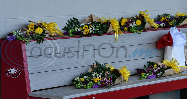 Flowers line the Rusk Eagles softball dugout on Wednesday, May 13. The flowers were part of a surprise Senior Softball Night put on by new Head Coach Michael Williams.