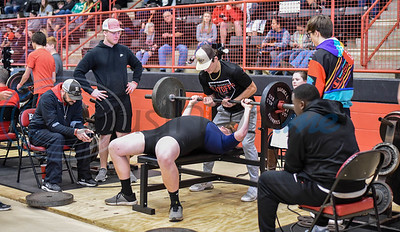 Rusk senior Brennan Lucien spots at lifter at the Rusk Invitational powerlifting meet on Saturday, January 25. The meet consisted of student athletes competing in squats, deadlifts and bench press for a final combined weight. (Jessica T. Payne/Tyler Morning Telegraph)