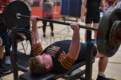 Rusk senior Nick Acker, who took first place in the 242 class, muscles through the bench press event at the Rusk Invitational on Saturday, January 25. (Jessica T. Payne/Tyler Morning Telegraph)