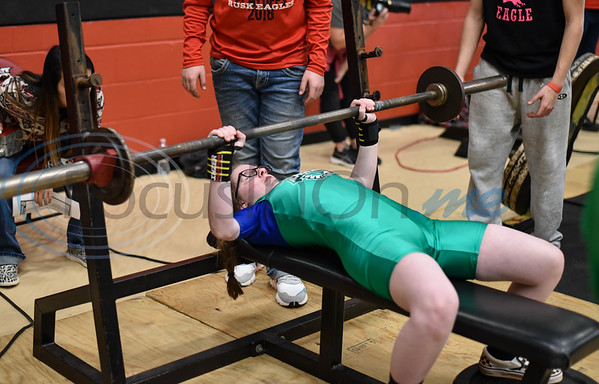 Sara Whitts of Tatum pushes through the bench press event at the Rusk Invitational on Saturday, January 25. The meet consisted of student athletes competing in squats, deadlifts and bench press for a final combined weight. (Jessica T. Payne/Tyler Morning Telegraph)