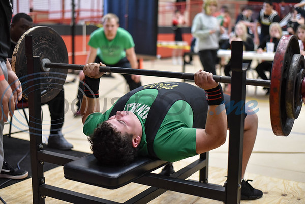 An Overton student athlete competes in bench press while his coach looks on at the annual Rusk Invitational powerlifting meet on Saturday, January 25. More than 10 school gathered at the Rusk Coliseum to compete in squats, deadlifts and bench press. (Jessica T. Payne/Tyler Morning Telegraph)
