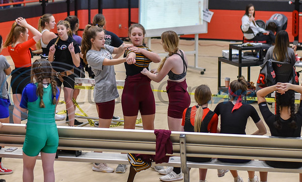 Troup female student athletes assist each other before a lift at the annual Rusk Invitational powerlifting meet on Saturday, January 25. More than 10 school gathered at the Rusk Coliseum to compete in squats, deadlifts and bench press. (Jessica T. Payne/Tyler Morning Telegraph)