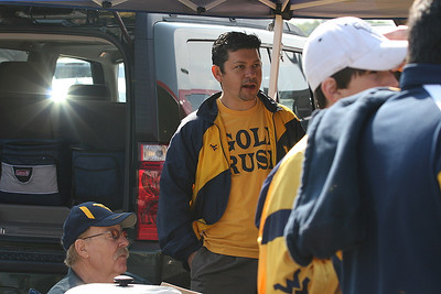 Pics with West Virginia fans tailgate party.