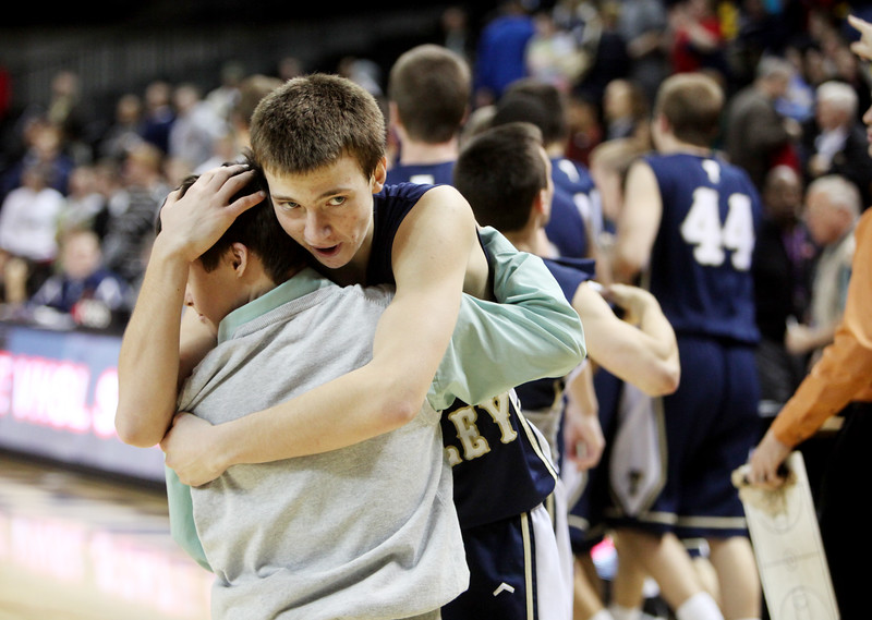 JEANNA DUERSCHERL | The Roanoke Times<br /> 03/08/11 Carter Wright hugs a friend after defeating Liberty in overtime during their state semifinal game held at the VCU Siegel Center.