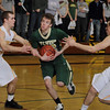 Record-Eagle/Keith King<br /> Traverse City West's Jeremiah Williams drives to the basket between Traverse City Central's Ryan Verschuren, left, and Mack Sovereign, right, Monday at Traverse City Central High School.