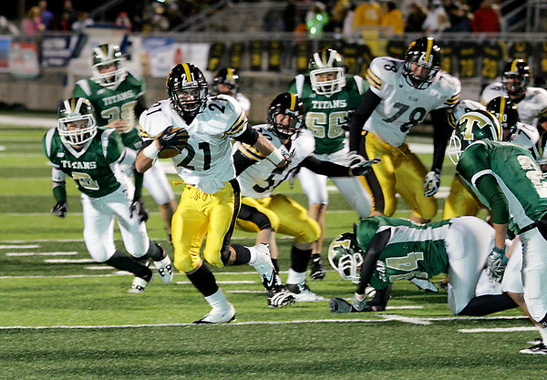 Record-Eagle/Keith King<br /> Traverse City Central's Ryan Verschuren sprints toward the end zone for a fourth quarter touchdown.