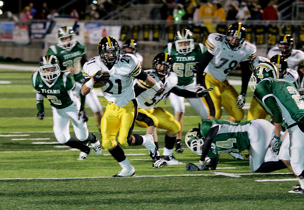 Record-Eagle/Keith King<br /> Traverse City Central's Ryan Verschuren runs the ball toward the end zone for a touchdown against Traverse City West Friday, September 30, 2011 at Thirlby Field.