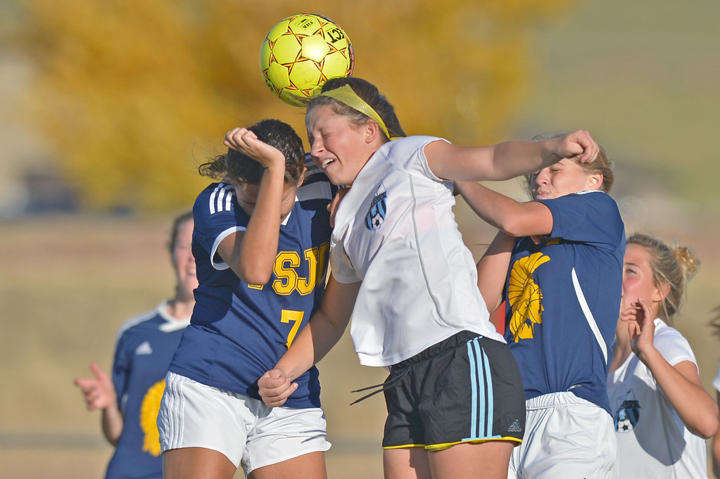 Sheridan College's Hannah Ozmon heads the ball in a crowd of people during the Lady Generals' Region IX Tournament match against Trinidad State Junior College on Friday, Oct. 20 at Maier Field. Mike Pruden | The Sheridan Press