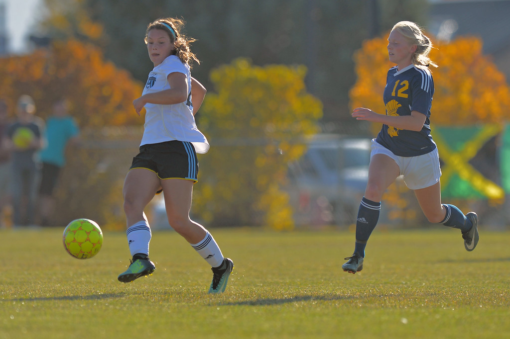 Sarah Jones, left, passes the ball during Sheridan College's Region IX Tournament match against Trinidad State Junior College on Friday, Oct. 20 at Maier Field. Mike Pruden | The Sheridan Press
