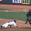 Gregor Blanco hurries back to first.