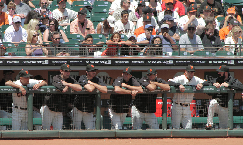 August 6, 2011:  From left, third base coach Tim Flannery, OF Pat Burrell, P Barry Zito, RP Jeremy Affeldt, P Madison Bumgarner, C Chris Stewart and RP Brian Wilson up on the top step.