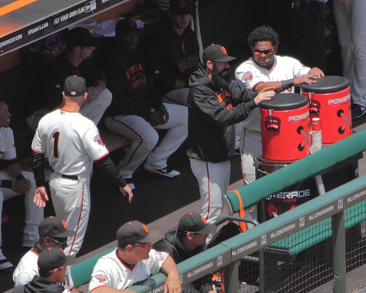 Brian Wilson and Pablo Sandoval play bongos on the Power-Aide containers before the game.  June 25th, 2011.  Take from View Box 311, Row D.