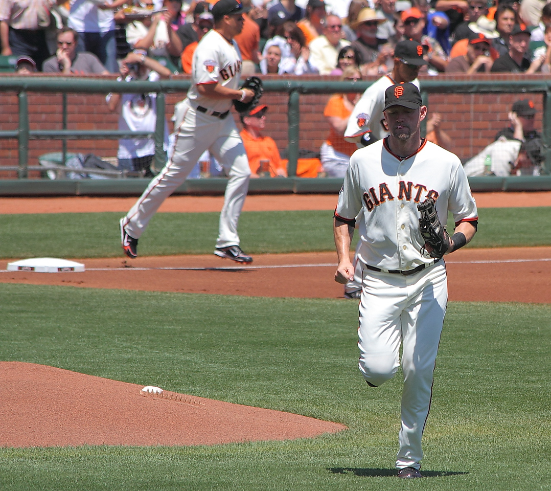 A Huff runs out to his first base position in the top of the first inning.