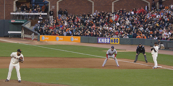 Sergio Romo looks in and keeps St. Louis baserunner Jim Edmunds close at first in May, 2009.