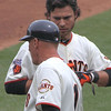 Rookie Brandon Crawford recieves some sage advice  from coach Tim Flannery.