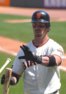 Aaron Rowand exchanges bats after breaking one on a swing.