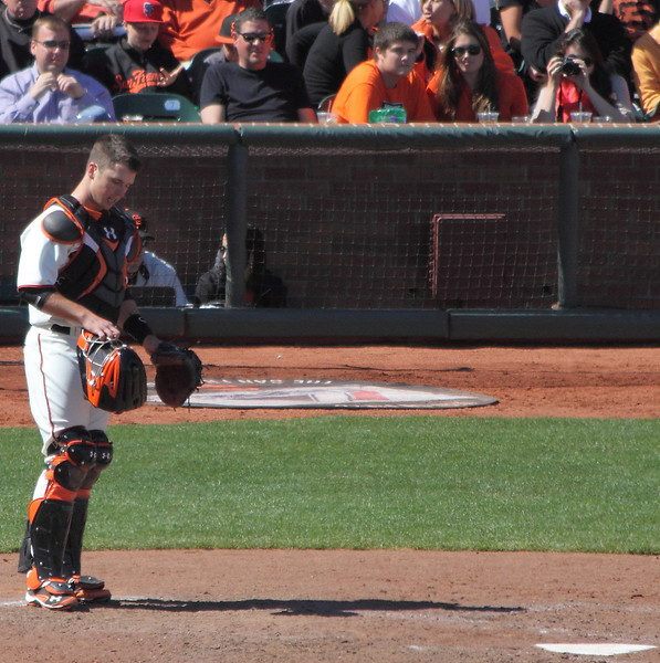 Buster Posey trying to shake off a foul tip that dinged him.